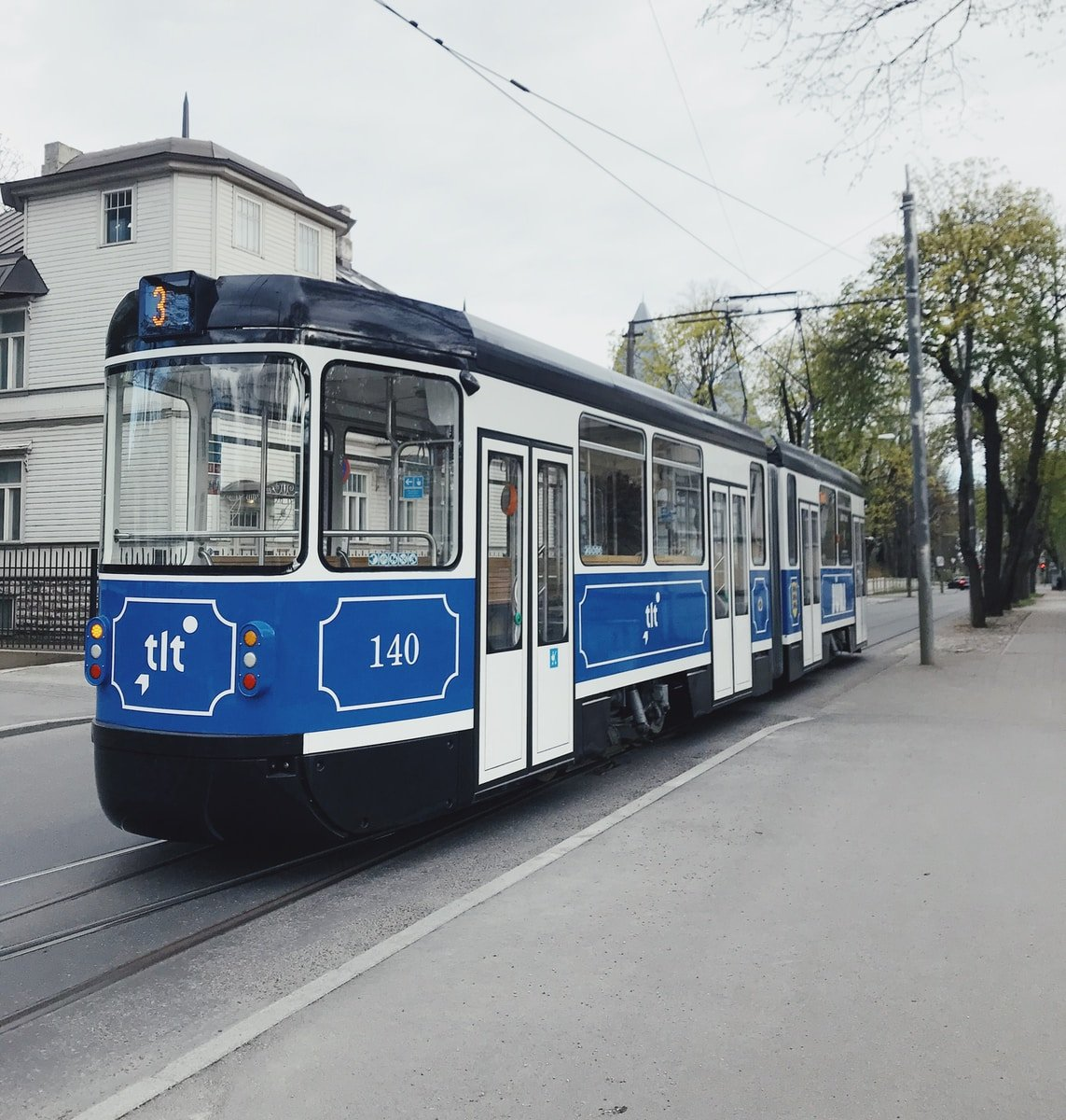 white and blue train on rail road during daytime